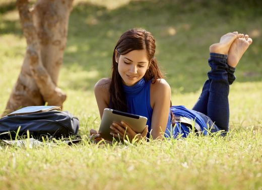 photodune-4134774-woman-with-books-and-tablet-studying-for-college-test-m-520x378